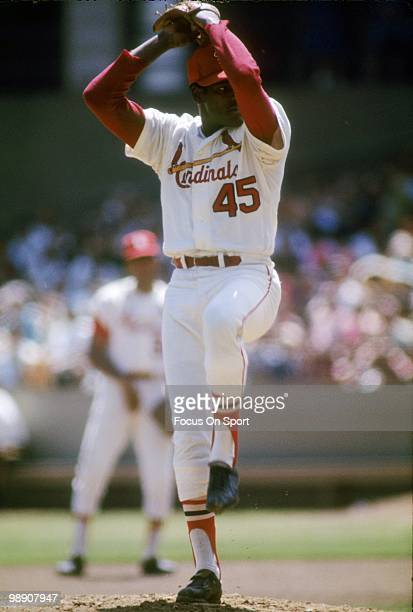 ST LOUIS MO CIRCA 1960's Pitcher Bob Gibson of the St Louis Cardinals winds up to throw a pitch circa late 1960's during a Major League Baseball game...