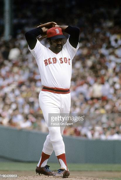 BOSTON MA CIRCA 1970's Pitcher Luis Tiant of the Boston Red Sox winds up to throw a pitch during a circa mid 1970's Major League Baseball game at...