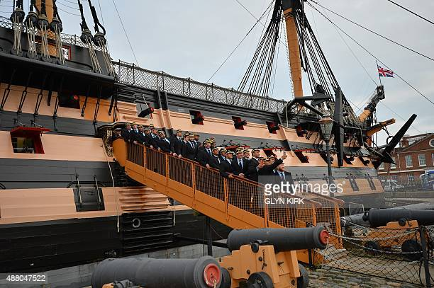 USA's players on the gangway of HMS Victory in Portsmouth southern England on September 13 following their official Welcoming Ceremony for the 2015...