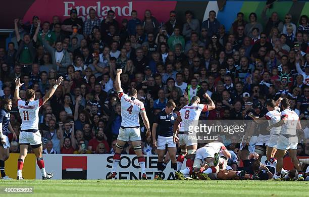 USA's players react after their prop Titi Lamositele scored their first try during a Pool B match of the 2015 Rugby World Cup between Scotland and...