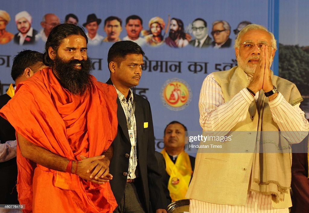 BJP's PM candidate and Gujarat Chief Minister Narendra Modi and Yog Guru Ramdev at the 5th foundation day celebrations of 'Bharat Swabhiman' on January 5, 2014 in New Delhi, India. Launching a fresh offensive against the Congress, Modi said, ''Dont trust anyone because of mere promises. Judge the track-record, and not tape record.' Modi promised to review and reform of the taxation system in the country, saying the existing structure is a burden on common man. Modi pointed out Ramdev, who had said his support to the saffron party would be issue-based, had joined the peoples movement. Modi further said, We have the will-power to transform the country. The way to end corruption is by making the state progressive and policy driven.'