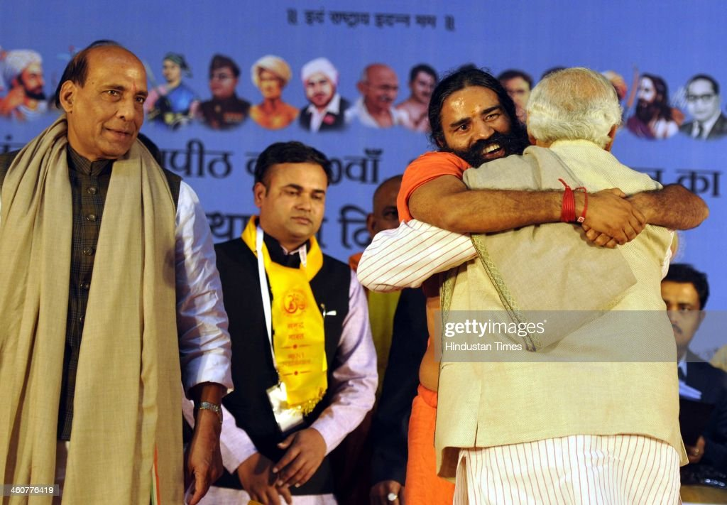 BJP's PM candidate and Gujarat Chief Minister Narendra Modi, BJP National President Rajnath Singh and Yog Guru Ramdev at the 5th foundation day celebrations of 'Bharat Swabhiman' on January 5, 2014 in New Delhi, India. Launching a fresh offensive against the Congress, Modi said, ''Dont trust anyone because of mere promises. Judge the track-record, and not tape record.' Modi promised to review and reform of the taxation system in the country, saying the existing structure is a burden on common man. Modi pointed out Ramdev, who had said his support to the saffron party would be issue-based, had joined the peoples movement. Modi further said, We have the will-power to transform the country. The way to end corruption is by making the state progressive and policy driven.'