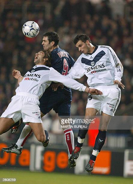 PSG's Portuguese striker Pedro Miguel Pauleta vies with Bordeaux's defenders Argentinian Mauricio Pochettino and Bruno Basto during their French...