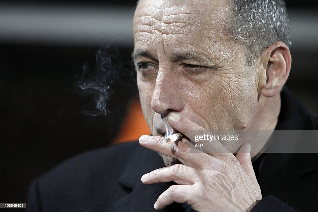 ACA's president Alain Orsoni smokes a cigarette before the French L1 football match between Ajaccio (ACA) and Rennes (SRFC), at the Francois Coty stadium in Ajaccio, on the French mediterranean island of Corsica, on December 22, 2012. AFP PHOTO / PASCAL POCHARD-CASABIANCA