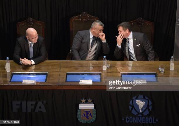 AFA's President Claudio Tapia chats with CONMEBOL's President Alejandro Dominguez next to FIFA's President Gianni Infantino at Argentine Football...