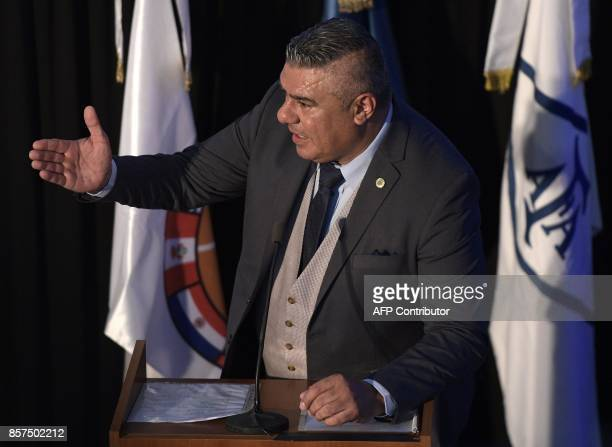 AFA's President Claudio Tapia delivers a speech next to FIFA's President Gianni Infantino and CONMEBOL's President Alejandro Dominguez at Argentine...