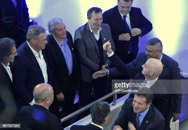 FIFA's President Gianni Infantino AFA's President Claudio Tapia and CONMEBOL's President Alejandro Dominguez talk to Argentina's former footballers...