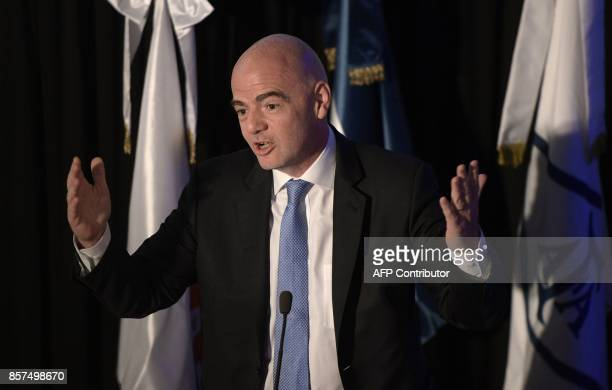 FIFA's President Gianni Infantino delivers a speech at Argentine Football Assosiation headquarters in Buenos Aires on October 4 2017 / AFP PHOTO /...