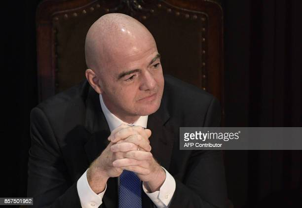FIFA's President Gianni Infantino gestures while listens to CONMEBOL's President Alejandro Dominguez speech at Argentine Football Assosiation...