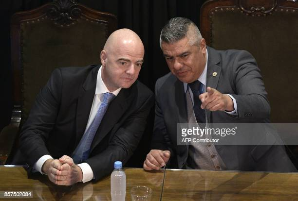 FIFA's President Gianni Infantino listens to AFA's President Claudio Tapia at Argentine Football Assosiation headquarters in Buenos Aires on October...