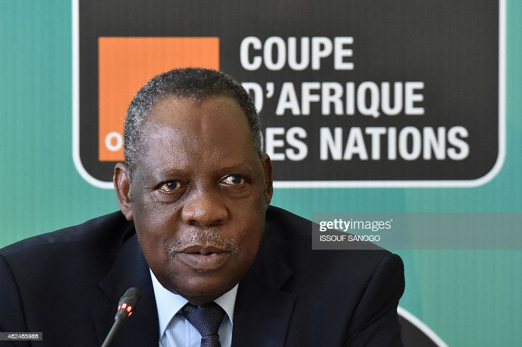 CAF's president Issa Hayatou speaks during a draw between Mali and Guinea in Malabo on January 29, 2015. Guinea qualified for the Africa Cup of Nations quarter-finals today after a drawing of lots was required to separate them and Mali.