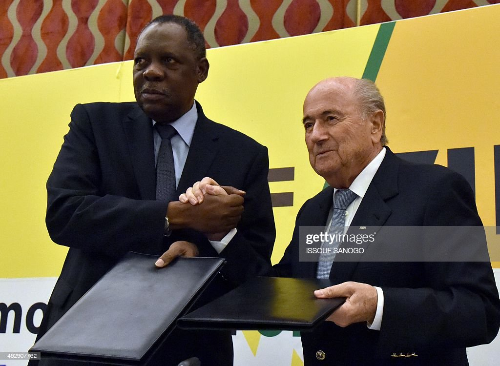 FIFA's president Joseph Sepp Blater and CAF's president Issa Hayatou pose after signing agreements on Febuary 7 2015 in Malabo AFP PHOTO / ISSOUF...