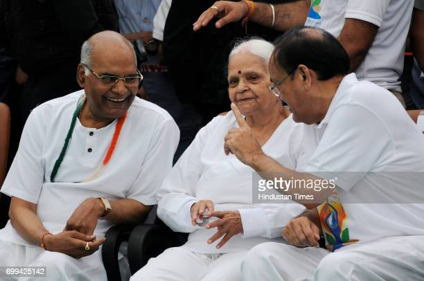 NDA's Presidential candidate Ram Nath Kovind and Union Minister M Venkaiah Naidu during the International Day of Yoga celebrations at Connaught Place...