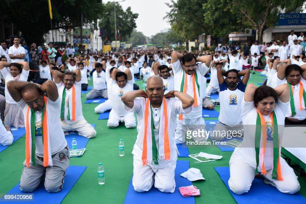 NDA's Presidential candidate Ram Nath Kovind Union Minister Vijay Goel and Member of Parliament Meenakshi Lekhi during the International Day of Yoga...