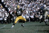 BAY WISCONSIN CIRCA 1960's Quarterback Bart Starr of the Green Bay Packers is set to throw a pass against the Baltimore Colts during a circa 1960's...