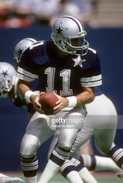 RUTHERFORD NJ CIRCA 1980's Quarterback Danny White of the Dallas Cowboys turns to hand the ball off to a running back against the New York Giants...