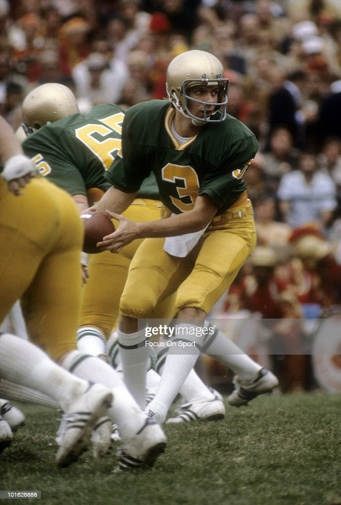 Quarterback Joe Montana #3 of the Notre Dame Fighting Irish turns to hand the ball off circa mid 1970's during NCAA football game at Notre Dame Stadium in South Bend, Indiana. Montana played for Notre Dame from 1974-78.