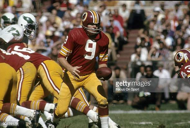 C CIRCA 1970's Quarterback Sonny Jurgensen of the Washington Redskins turns to hand the ball off to a running back against the Philadelphia Eagles...