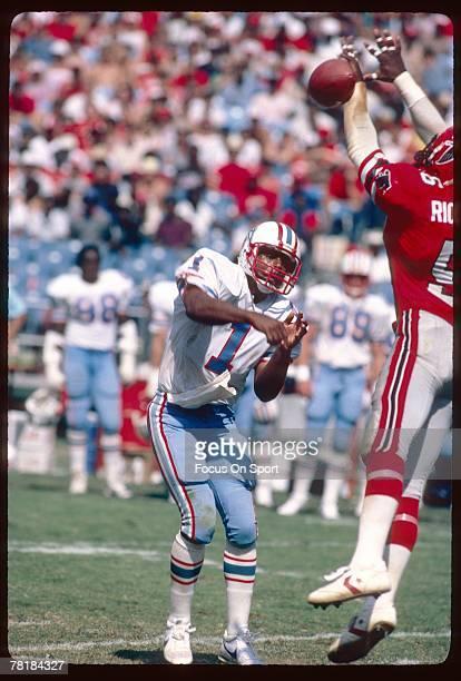 ATLANTA GA CIRCA 1980's Quarterback Warren Moon of the Houston Oilers throws a pass against the Atlanta Falcons during a mid circa 1980's NFL...