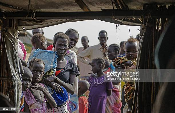 IDP's queue to register at the UNMISS Protection of Civilian site in Bentiu Unity State on February 27 2015 The camp receives up to 200 new IDP each...