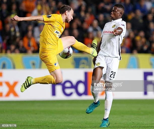 APOEL's Renan Bressan vies with Young Boys' Denis Zakaria during their UEFA Europa League football match between Cyprus' APOEL of Nicosia and...