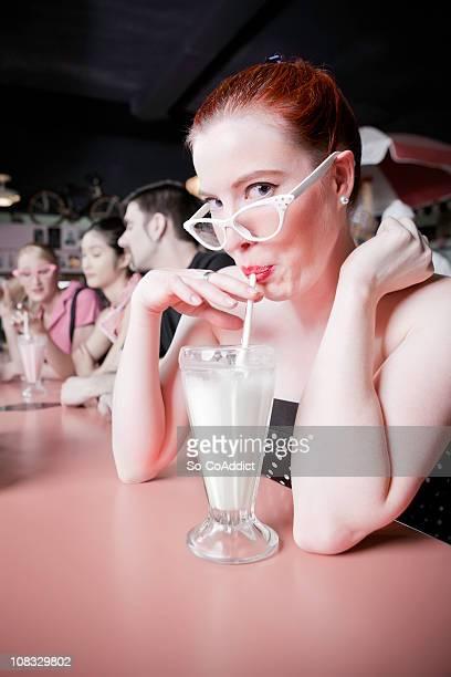 1950's Retro Girl Sipping Milkshake