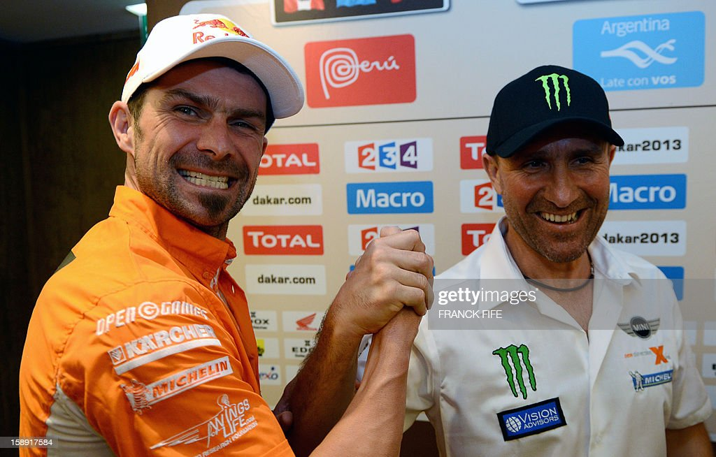 KTM's rider Cyril Despres (L) of France shakes hands with Mini's driver Stephane Peterhansel of France in Lima on January 3, 2013, ahead of the 2013 Dakar Rally which this year will thunder through Peru, Argentina and Chile from January 5 to 20.