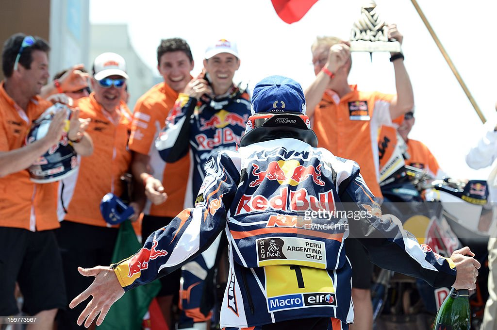 KTM's rider France's Cyril Despres reacts on the podium of the Rally Dakar 2013 in Santiago, Chile on January 20, 2013. Stephane Peterhansel claimed a record fifth Dakar Rally drivers title, and 11th overall of his career, while French compatriot Cyril Despres captured a fifth motorcycling crown.