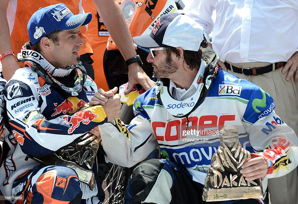 KTM's riders France's Cyril Despres and Francisco Chaleco Lopez of Chile shake hands on the podium of the Rally Dakar 2013 in Santiago, Chile on January 20, 2013. Stephane Peterhansel claimed a record fifth Dakar Rally drivers title, and 11th overall of his career, while French compatriot Cyril Despres captured a fifth motorcycling crown.