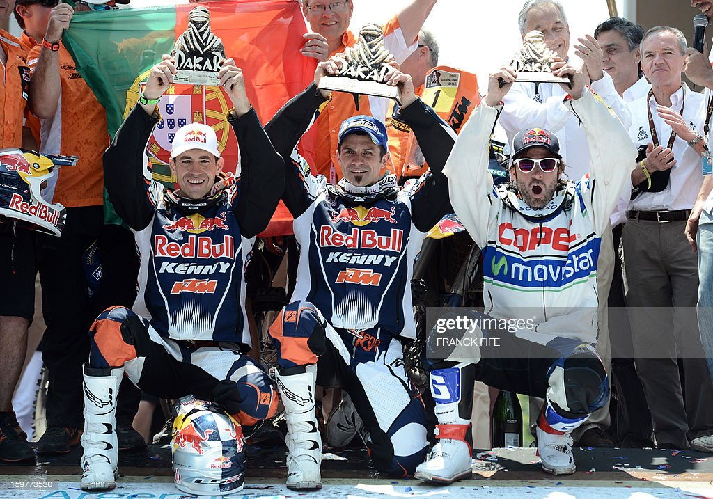 KTM's riders Ruben Faria of Portugal, France's Cyril Despres and Francisco Chaleco Lopez, of Chile pose on the podium of the Dakar 2013 in Santiago, Chile on January 20, 2013. Stephane Peterhansel claimed a record fifth Dakar Rally drivers title, and 11th overall of his career, while French compatriot Cyril Despres captured a fifth motorcycling crown. AFP PHOTO / FRANCK FIFE