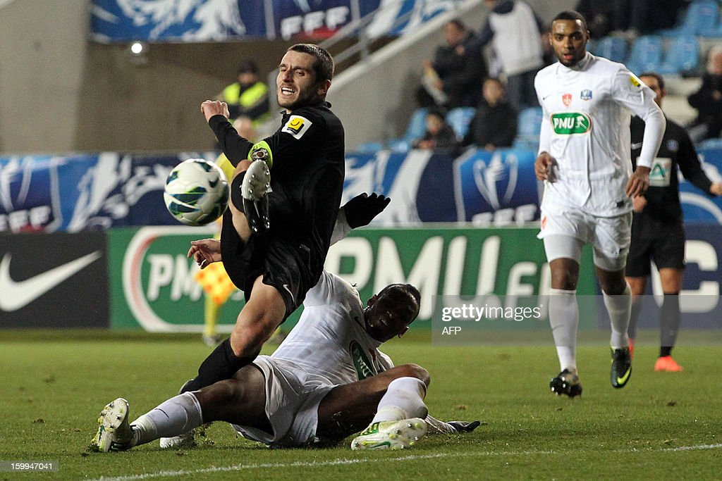 CAB's Romain Pastorelli (L) fights for the ball during the French football Cup match CA Bastia (CAB) vs Brest (SB29) at the Armand Cesari stadium in Bastia, French Mediterranean island of Corsica, on January 23, 2013.