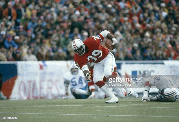 FOXBORO MA CIRCA 1970's Running back Sam Cunningham of the New England Patriots carries the ball against the Houston Oilers during a mid circa 1970's...