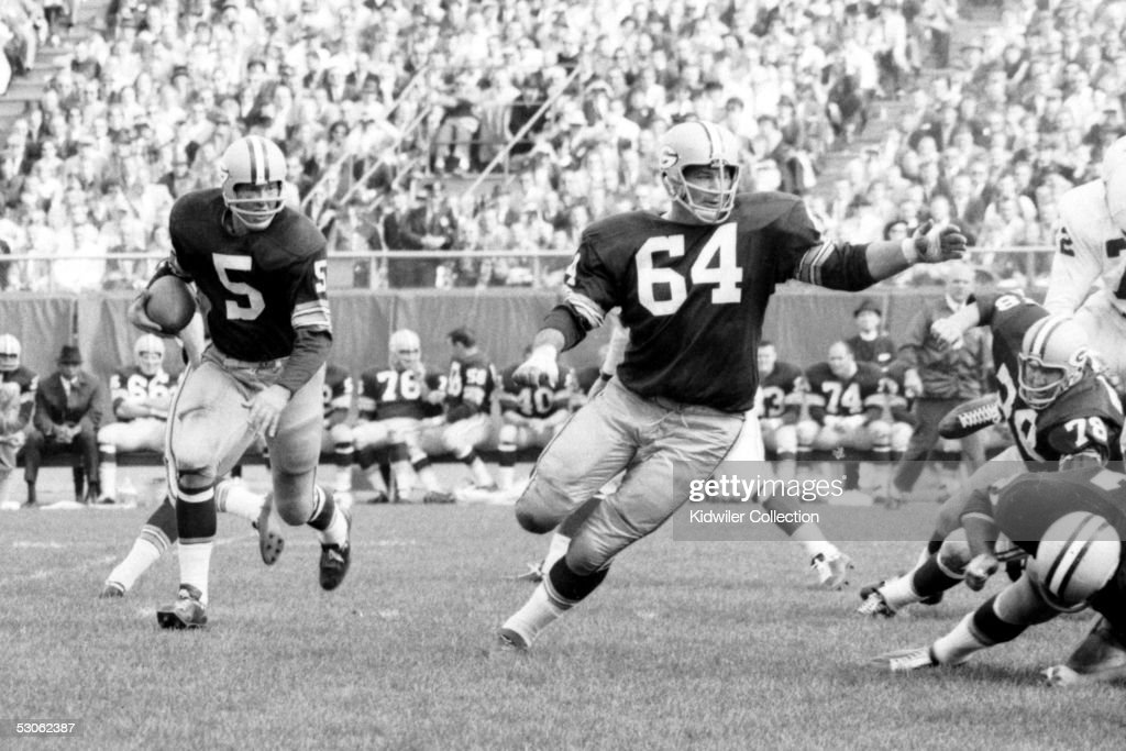 BAY WI 1960's Runningback Paul Hornung and Jerry Kramer of the Green Bay Packers run the 'Lombardi Sweep' during a game in the 1960's against the St...