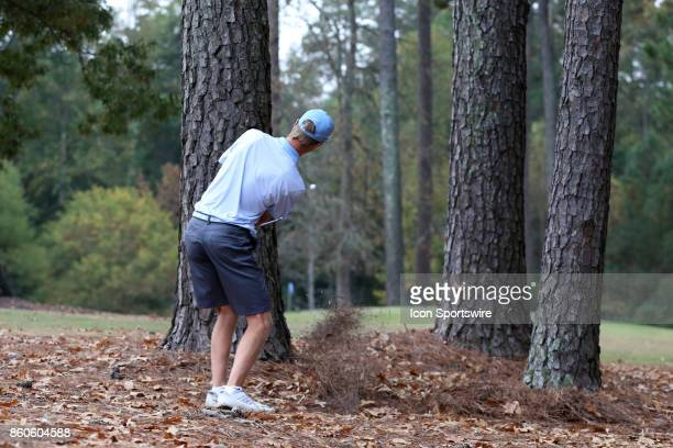 UNC's Ryan Gerard hits an approach shot between two trees on the 4th hole The first round of the Tar Heel Intercollegiate Men's Golf Tournament was...