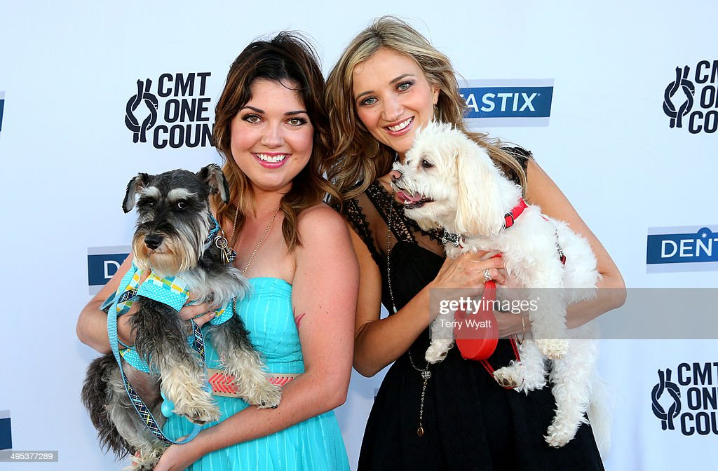 CMT's Samantha Stephens and <a gi-track='captionPersonalityLinkClicked' href=/galleries/search?phrase=Sarah+Darling&family=editorial&specificpeople=7262712 ng-click='$event.stopPropagation()'>Sarah Darling</a> enjoy the CMT One Country & Dentastix Smile! Party with their pets on June 2, 2014 in Nashville, Tennessee.