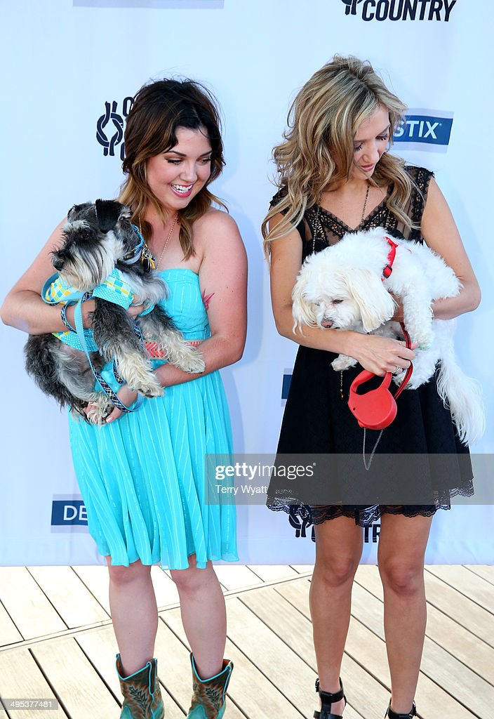 CMT's Samantha Stephens and Sarah Darling enjoy the CMT One Country & Dentastix Smile! Party with their pets on June 2, 2014 in Nashville, Tennessee.