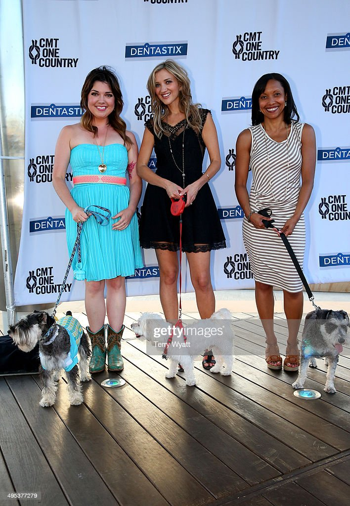 CMT's Samantha Stephens, Sarah Darling, and Dentastix's Lisa Campbell enjoy the CMT One Country & Dentastix Smile! Party with their pets on June 2, 2014 in Nashville, Tennessee.