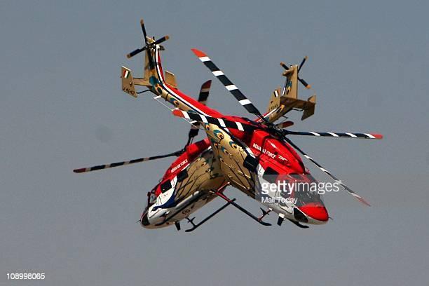 IAF's Sarang helicopters display their skills during the Aero India 2011 India's biggest air show at Yelahanka Air base in Bangalore on Thursday