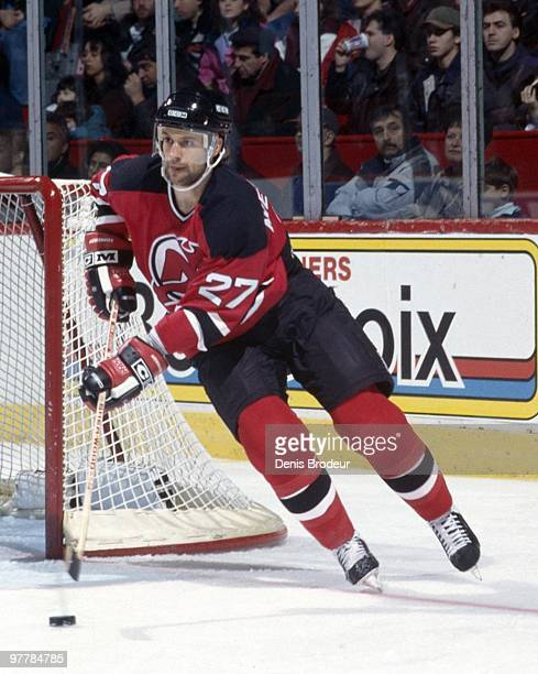 MONTREAL 1990's Scott Niedermayer of the New Jersey Devils skates with the puck against the Montreal Canadiens in the 1990's at the Montreal Forum in...
