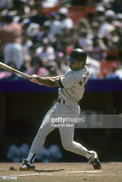 FLUSHING NY CIRCA 1980's Second baseman Roberto Alomar of the San Diego Padres swings and watches the flight of his ball against the New York Mets...