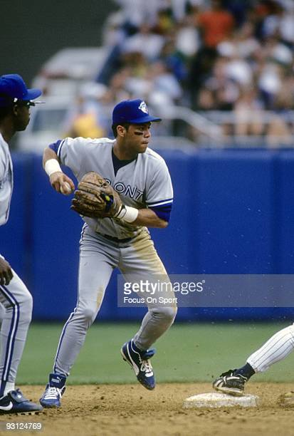 BRONX NY CIRCA 1990's Second baseman Roberto Alomar of the Toronto Blue Jays in action at second base against the New York Yankees during a circa...