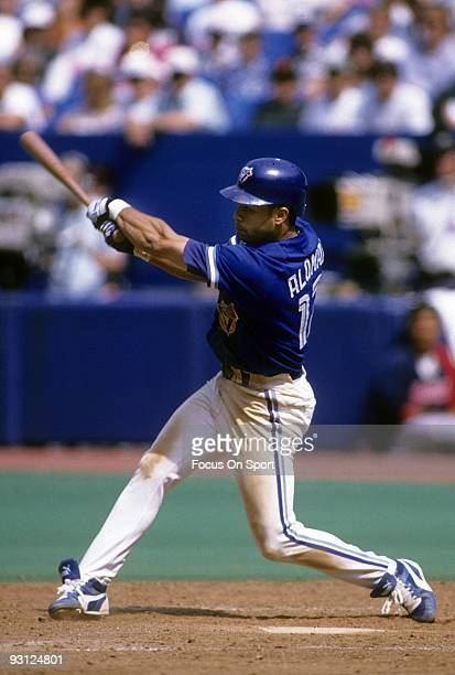 TORONTO ONTARIO CIRCA 1990's Second baseman Roberto Alomar of the Toronto Blue Jays swings and watches the flight of his ball during a circa early...