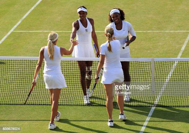 USA's Serena and Venus Williams after winning their doubles match against Germany's Sabine Lisicki and Canada's Aleksandra Wozniak during the 2009...