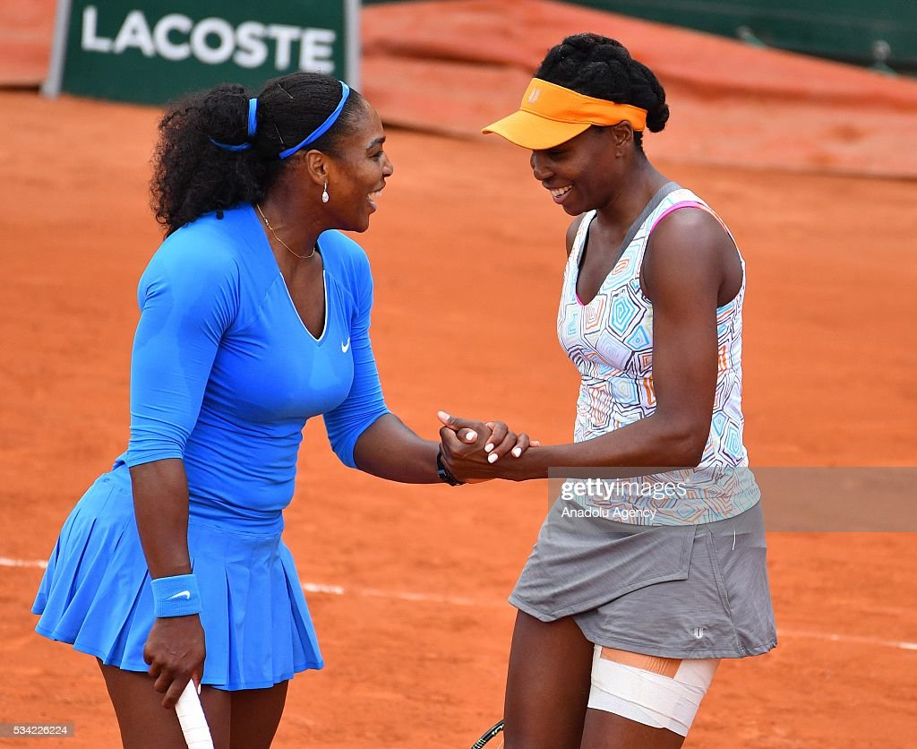 US's Serena Williams (L) and US's Venus Williams (R) celebrate after a point during their women's double first round match against Jelena Ostapenko of Latvia and Yulia Putintseva of Kazakhstan at the French Open tennis tournament at Roland Garros in Paris, France on May 25, 2016.