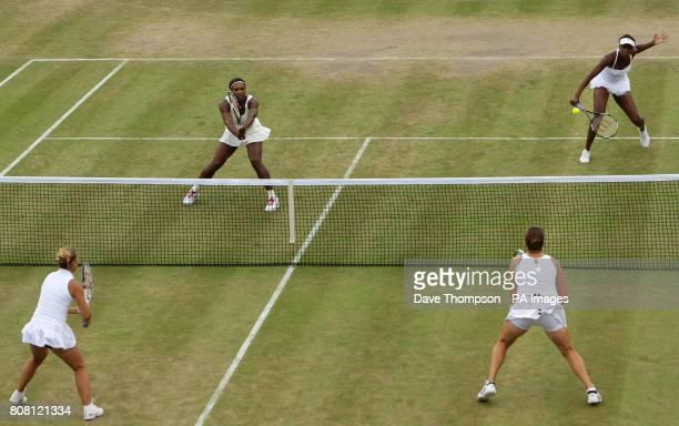 USA's Serena Williams and Venus Williams play Dominika Cibulkova and Anastasia Pavlyuchenkova during day six of the 2010 Wimbledon Championships at...