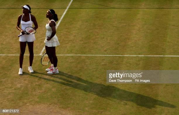 USA's Serena Williams and Venus Williams watch a hawkeye replay as they play Dominika Cibulkova and Anastasia Pavlyuchenkova during day six of the...
