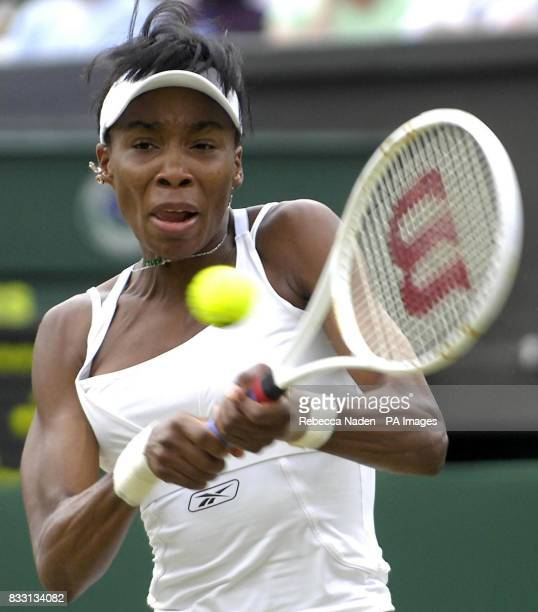 USA's Serena Williams in action against Russia's Svetlana Kuznetsova during The All England Lawn Tennis Championship at Wimbledon