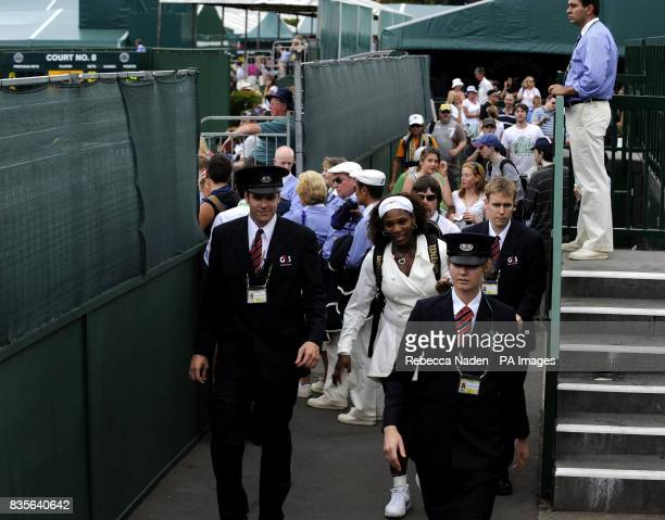 USA's Serena Williams leaves Court 2 after defeating Slovakia's Daniela Hantuchova during the Wimbledon Championships at the All England Lawn Tennis...