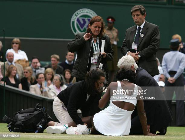 USA's Serena Williams receives treatment during her match against Slovakia's Daniela Hantuchova during The All England Lawn Tennis Championship at...