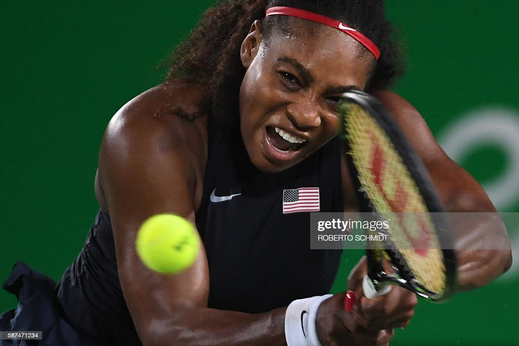TOPSHOT - USA's Serena Williams returns the ball to France's Alize Cornet during their women's second round singles tennis match at the Olympic Tennis Centre of the Rio 2016 Olympic Games in Rio de Janeiro on August 8, 2016. / AFP / Roberto SCHMIDT